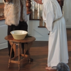 Two men dramatize the story of Jesus' baptism by John.