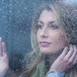 Free stock photo Thoughtful Woman Looking Through Window With Raindrops