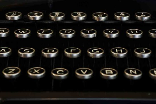 Free stock photo Close-up of alphabets and numbers on typewriter keys