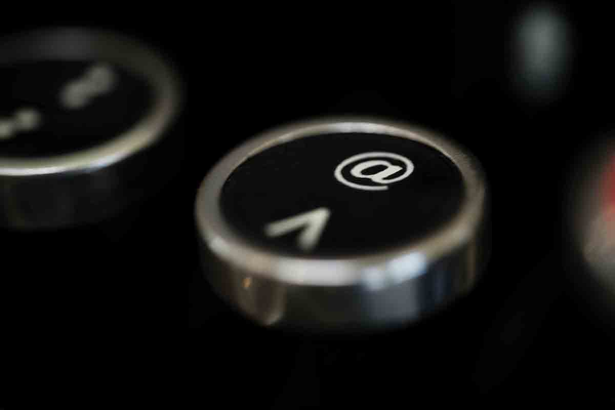 Free stock photo Close-up of at symbol on typewriter key