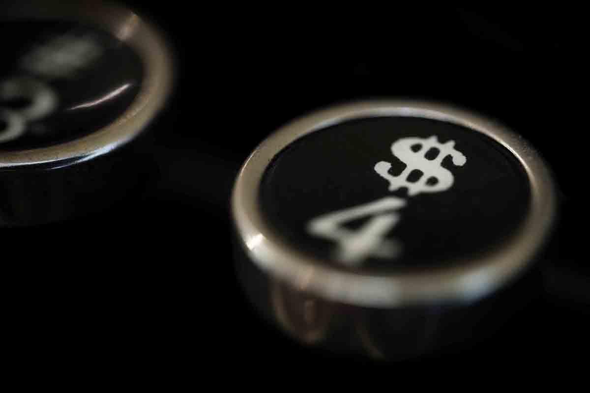 Free stock photo Close-up of dollar sign on typewriter key