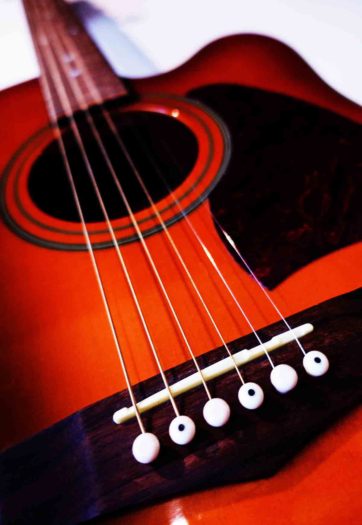 Free stock photo Close-up of red and black guitar