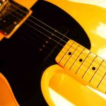 Free stock photo Close-up of yellow and black guitar