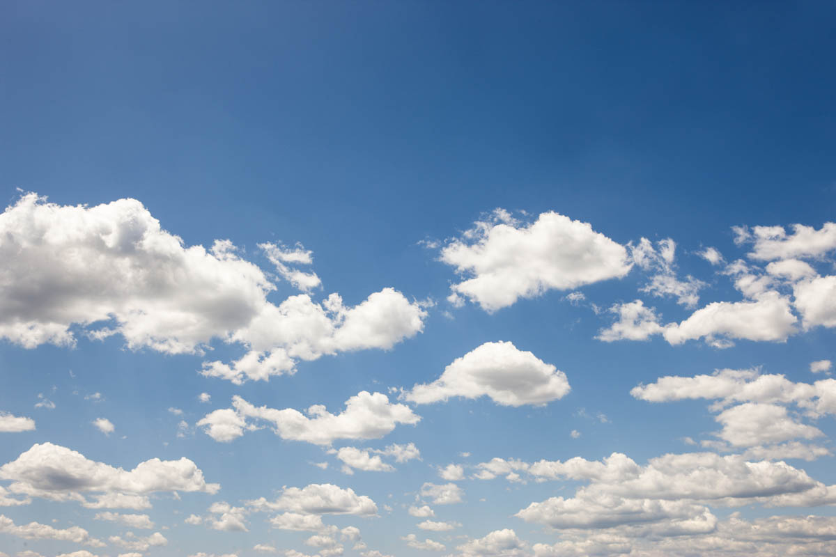 Free stock photo White clouds in a clear blue sky