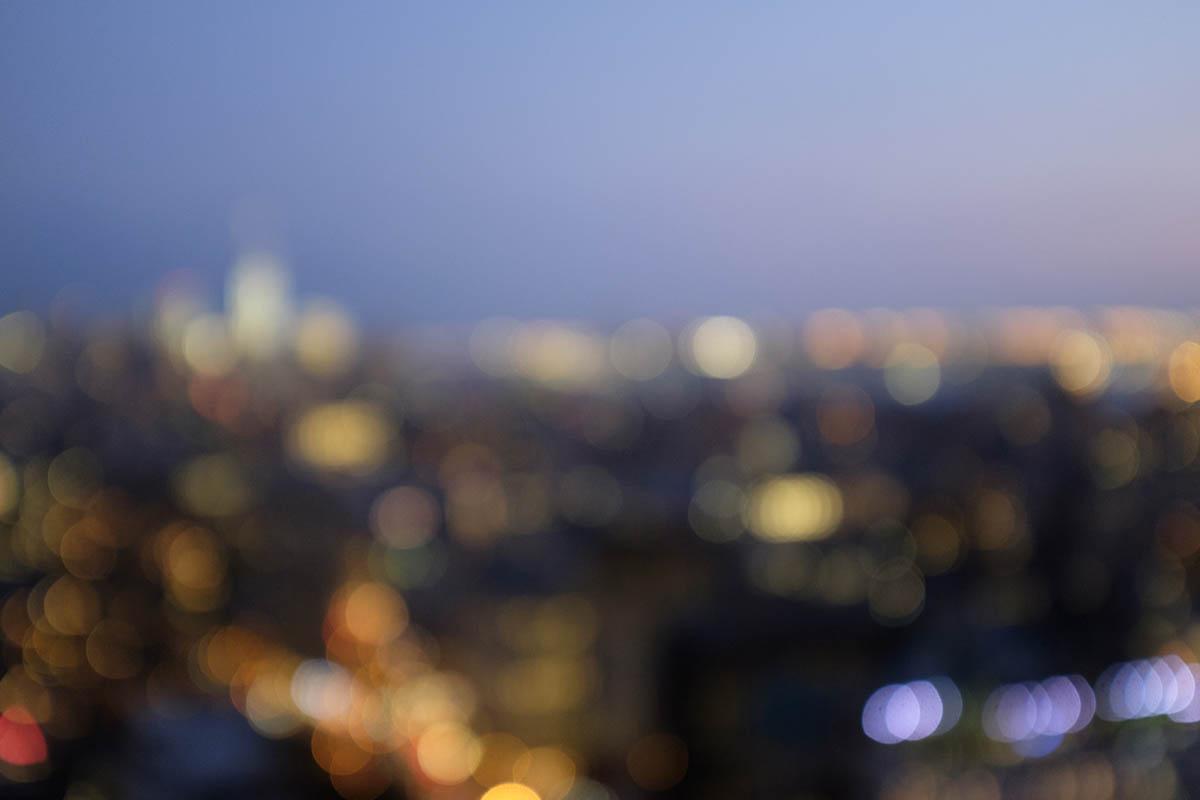 Free stock photo Defocused image of illuminated city at sunset