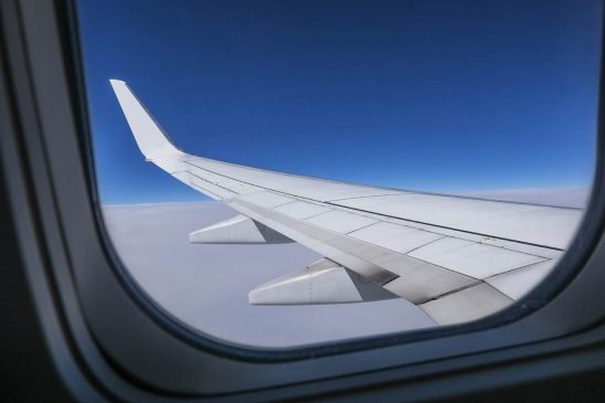Free stock photo Airplane wing seen through glass window