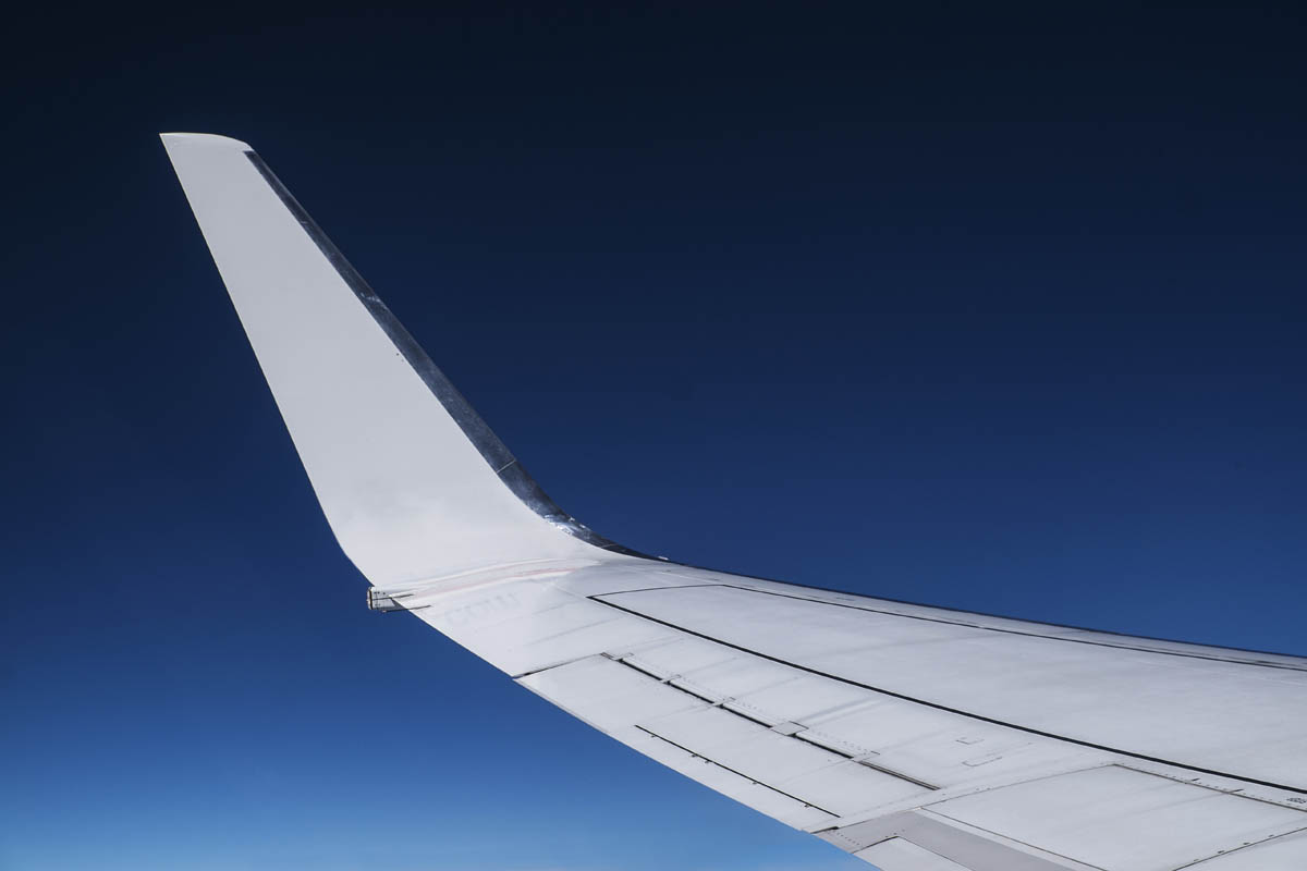 Free stock photo Close-up of airplane wing against blue sky
