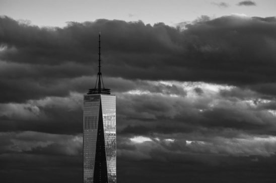 Free stock photo One world trade center against storm clouds in sky