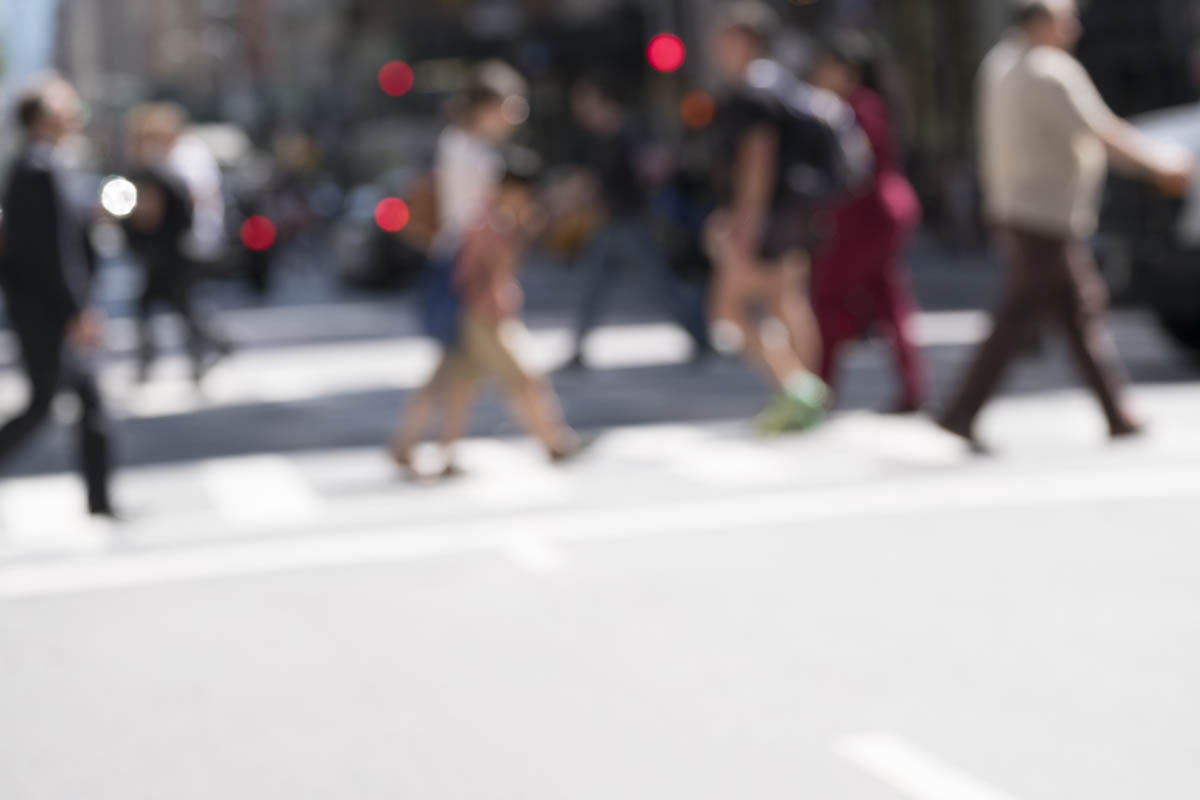 Free stock photo Defocused image of people crossing city street on sunny day