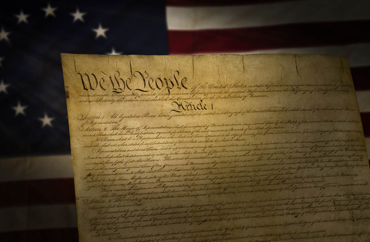 Free stock photo Close-up of us constitution against american flag