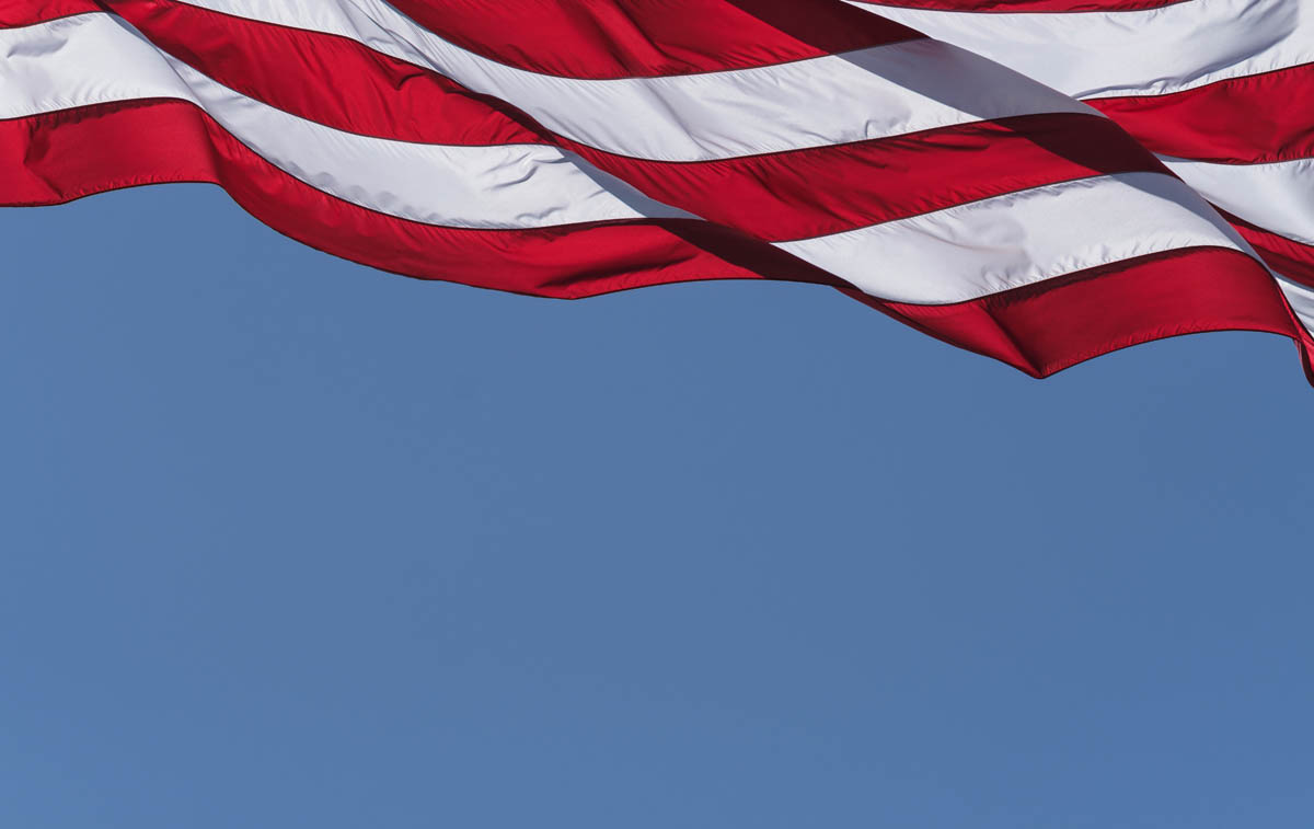 Free stock photo Low angle view of stripes on american flag against clear sky