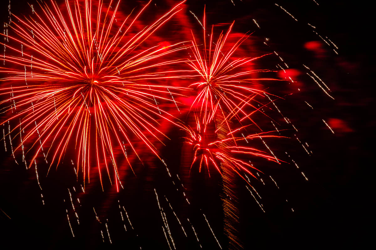 Free stock photo Low angle view of red firework display at night