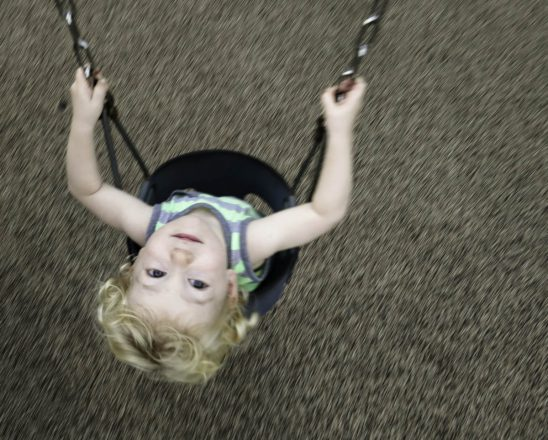 Free stock photo Directly above shot of boy on playground swing