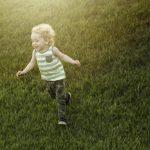 Free stock photo Happy boy running on grassy field