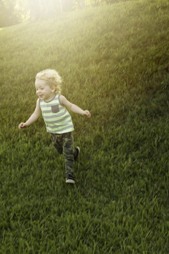 Free stock photo Happy boy running on grassy field