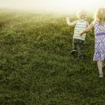 Free stock photo Rear view of children walking on grassy field