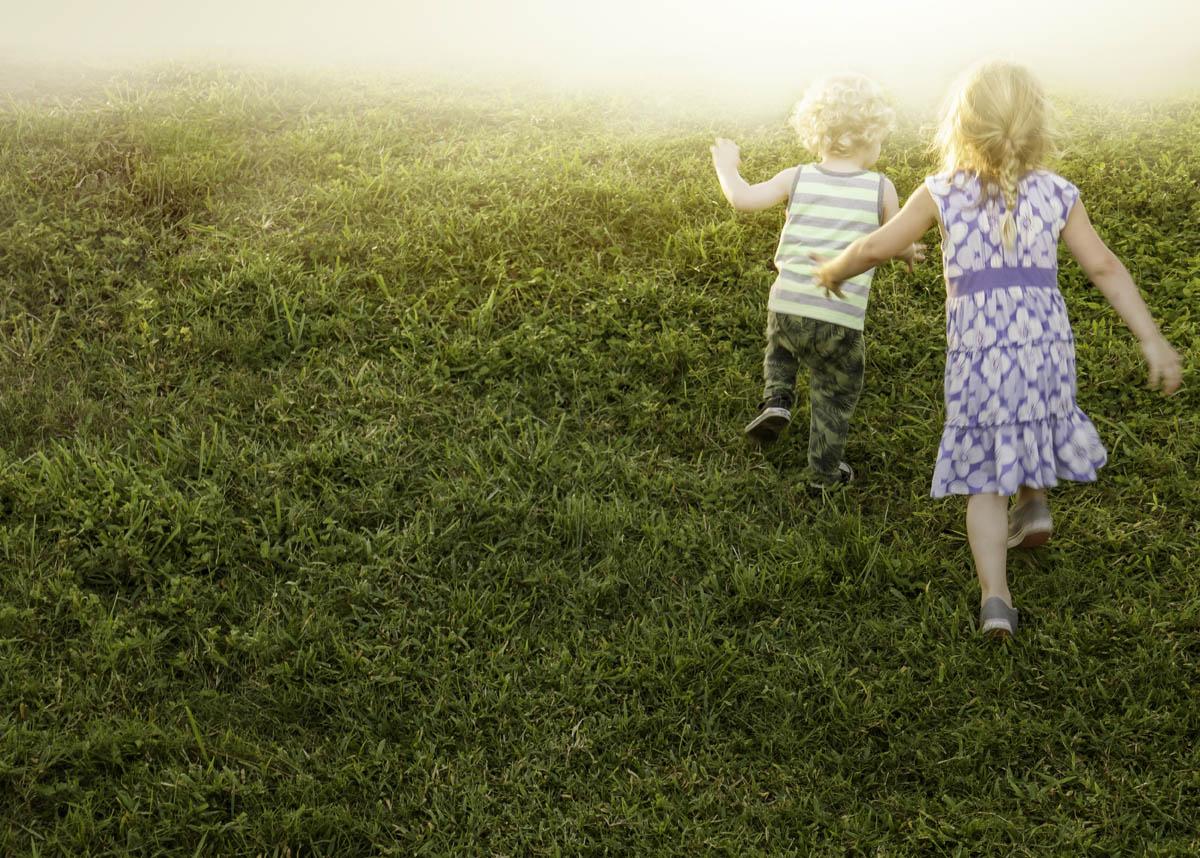 Free stock photo Rear view of children walking on grassy field