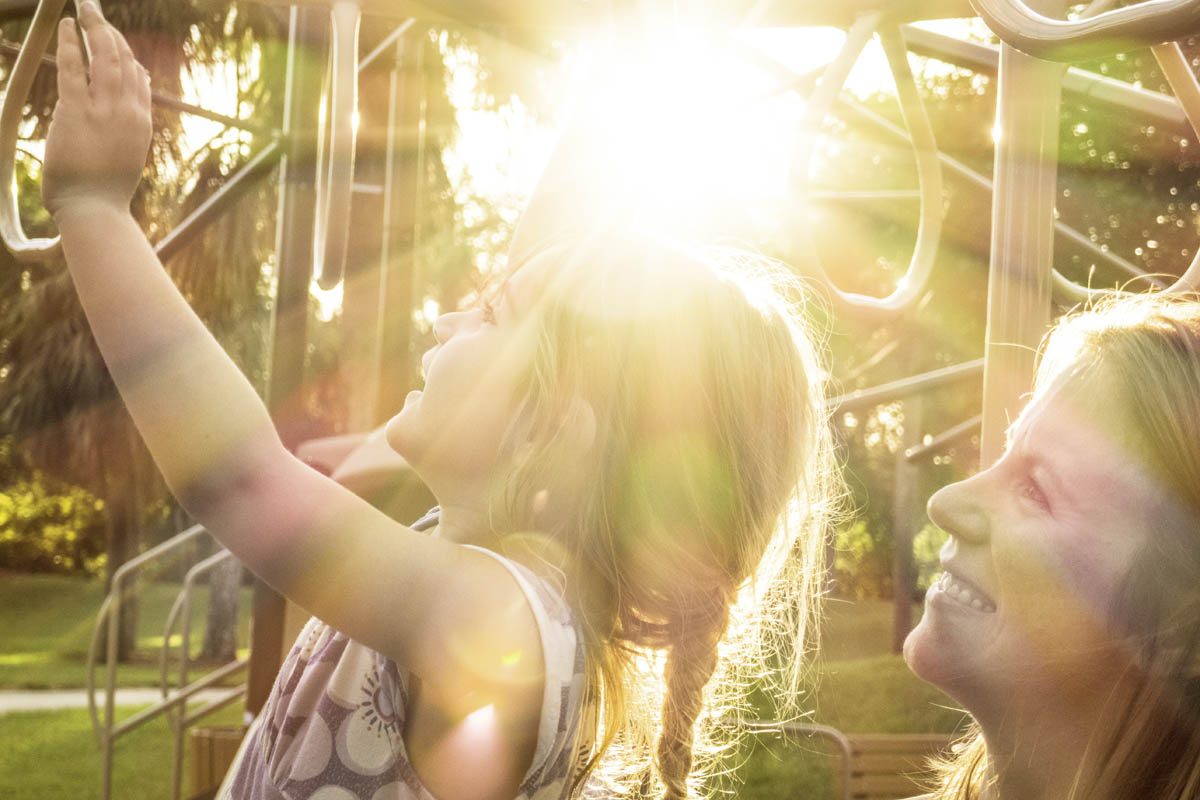 Free stock photo Happy mother looking at daughter playing in playground on sunny day