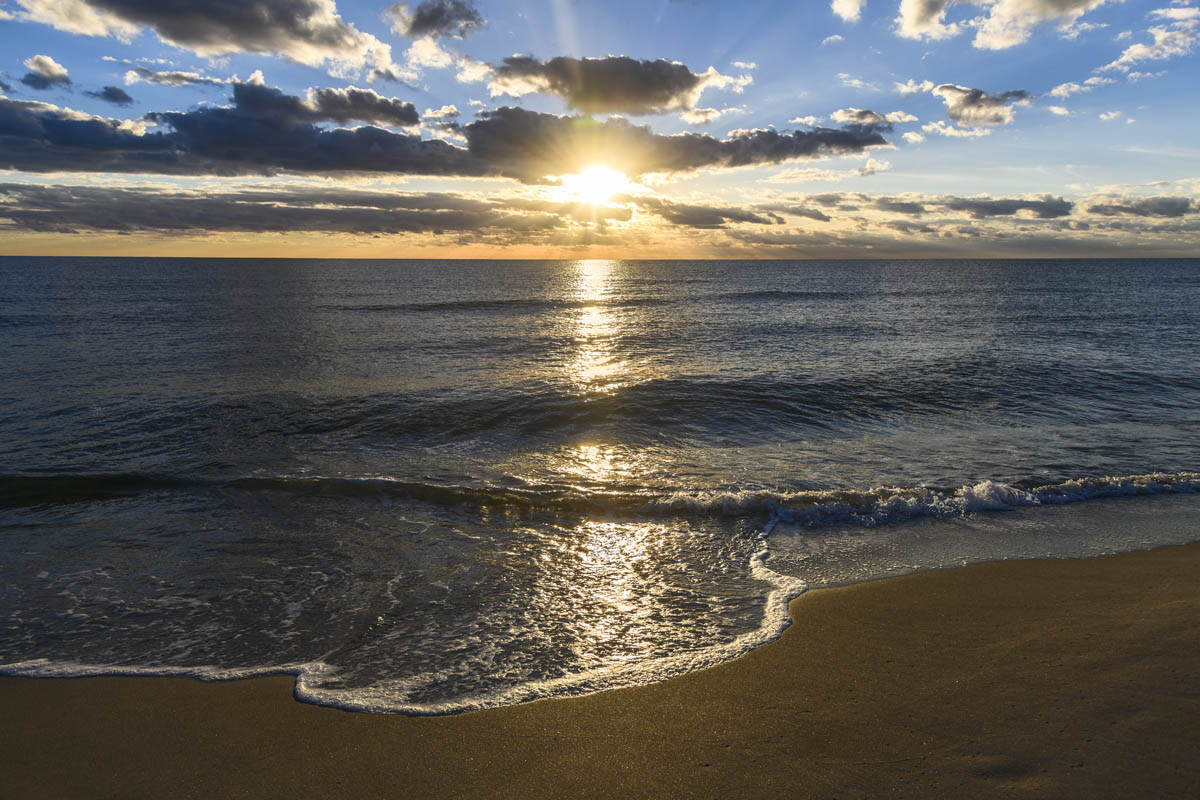 Free stock photo Scenic view of sea at beach against sky during sunset