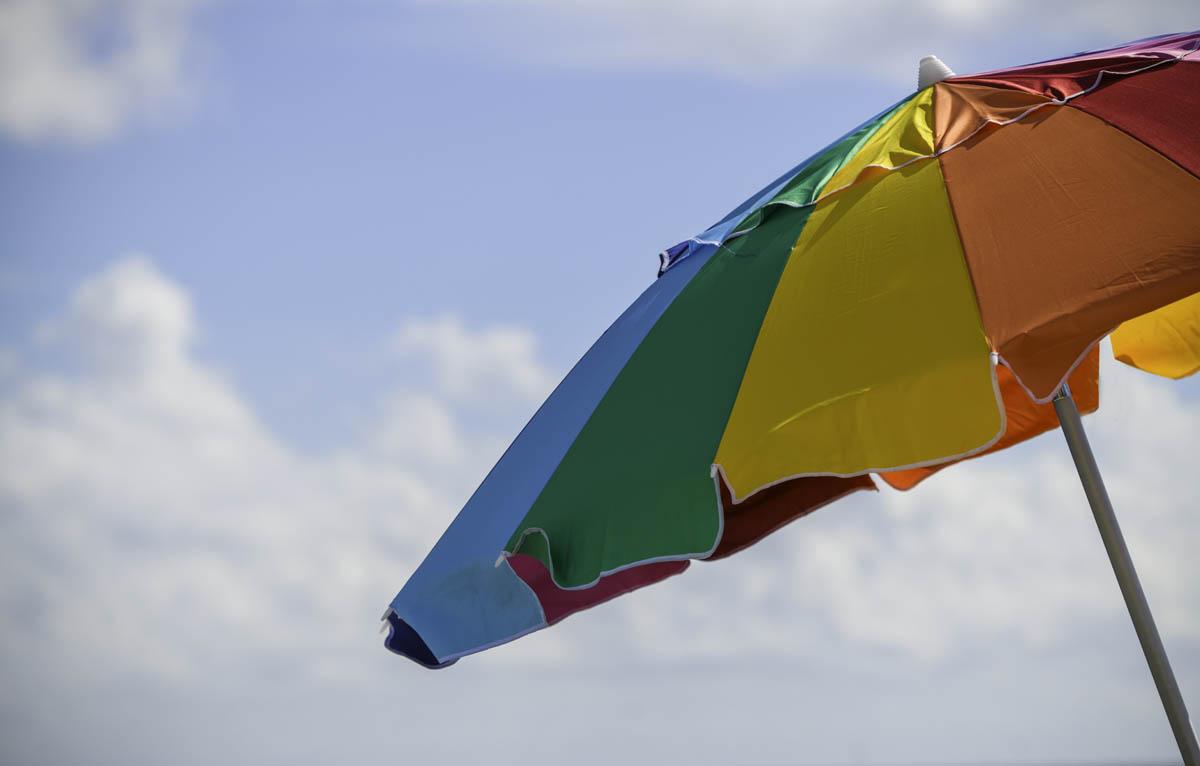 Free stock photo Close-up of colorful sunshade at beach