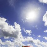 Free stock photo Colorful sunshade at beach against sky on sunny day
