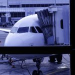 Free stock photo Airplane with passenger boarding bridge at airport seen through window