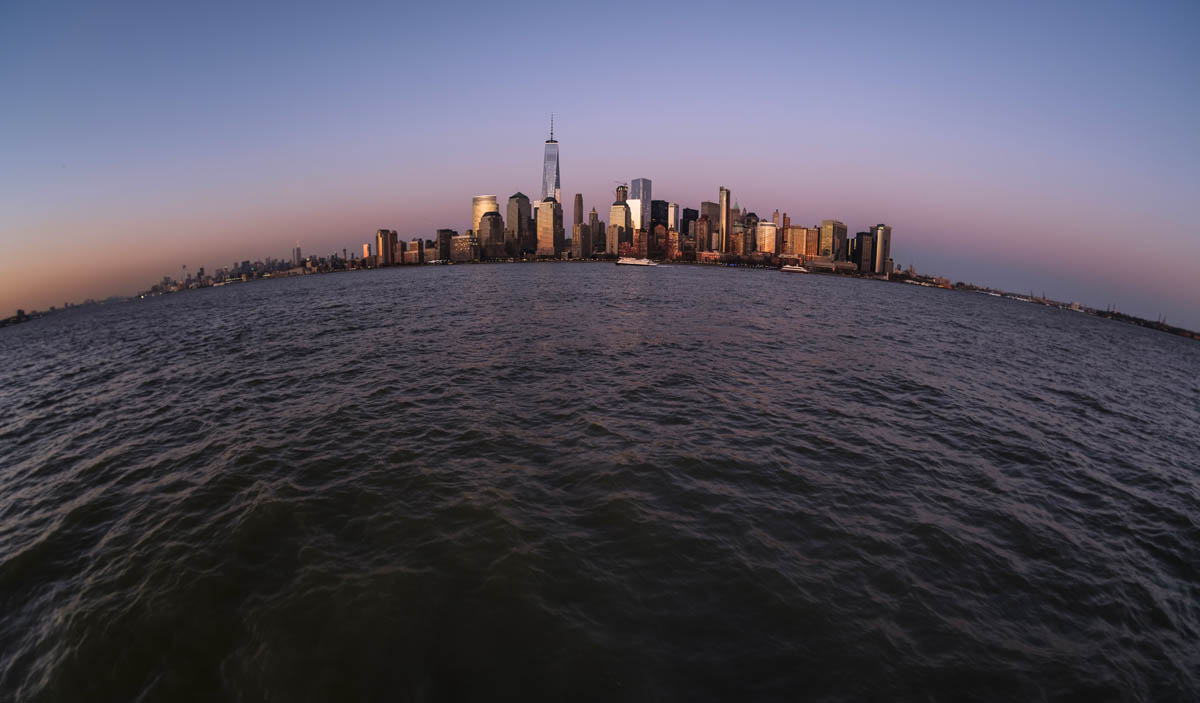 Free stock photo Fish-eye lens shot of cityscape and river during sunset
