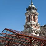 Free stock photo Low angle view of ellis island immigration museum against clear blue sky