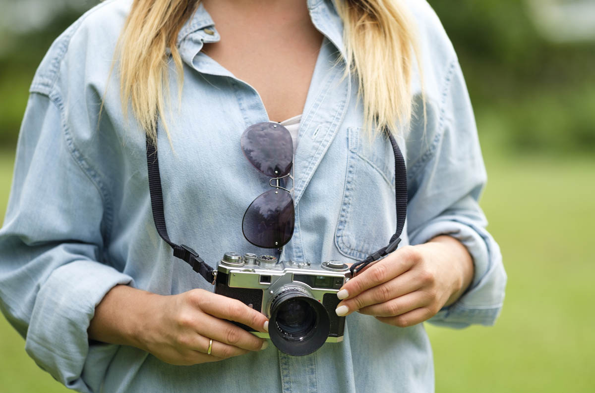 Free stock photo Midsection of woman holding camera outdoors