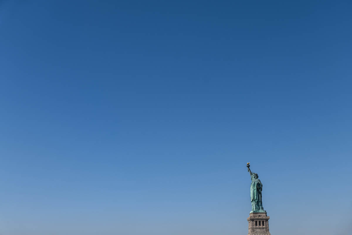 Free stock photo Statue of liberty against clear blue sky