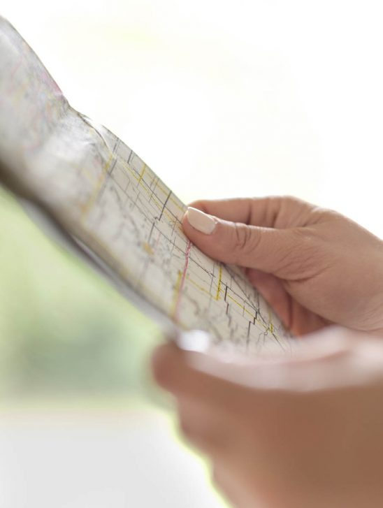 Free stock photo Close-up of hands holding map