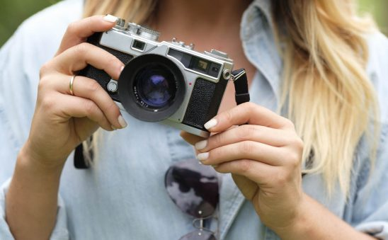 Free stock photo Partial view of woman holding vintage camera