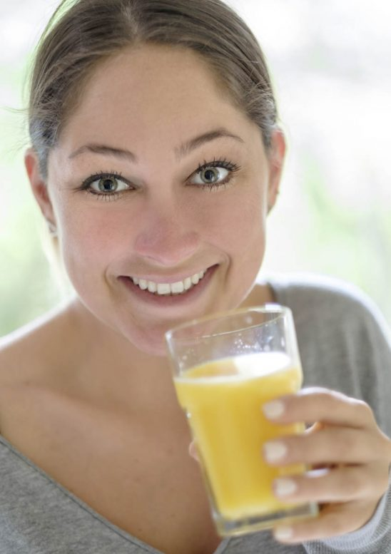 Free stock photo Portrait of happy woman drinking glass of fruit juice
