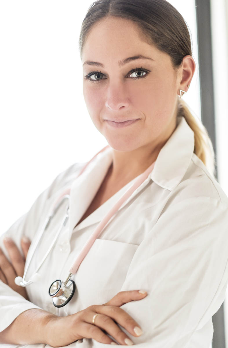 Free stock photo Portrait of female doctor with arms crossed in hospital