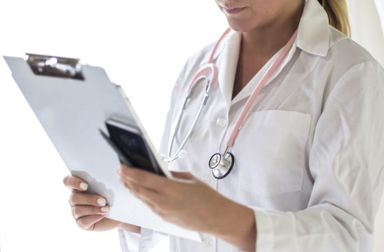 Free stock photo Partial view of female doctor holding clipboard