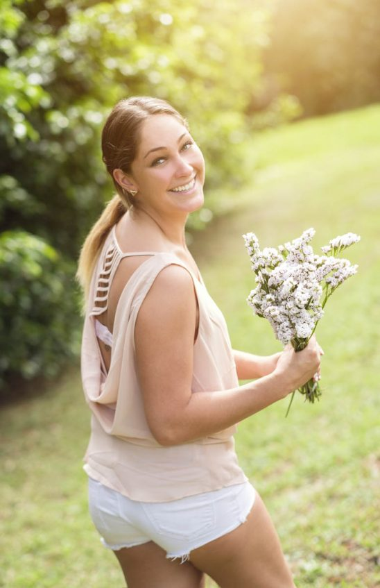 Free stock photo Portrait of smiling woman holding bouquet in park