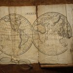 Free stock photo Close-up of vintage eyeglasses on world map