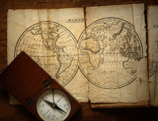 Free stock photo Close-up of world map and compass on table