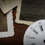 Free stock photo Close-up of antique watch face and photographs on wooden table