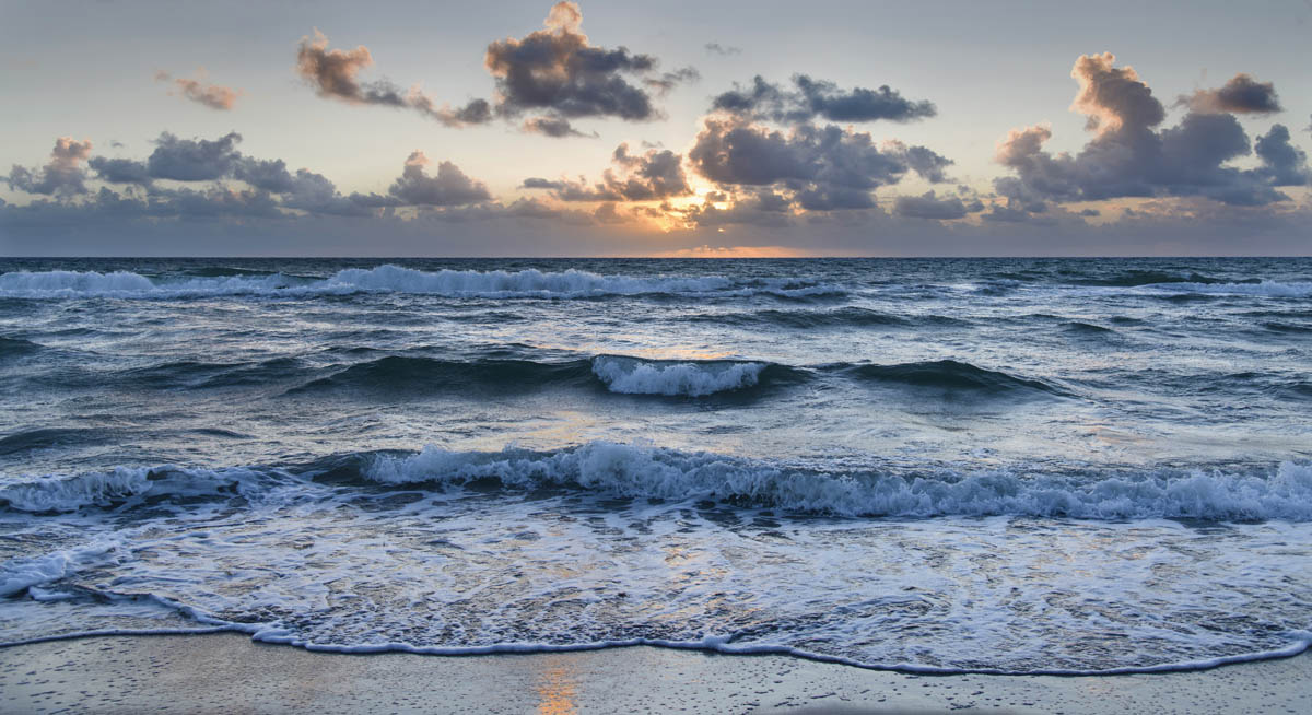 Free stock photo Waves rushing in sea at beach against sky during sunset