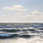 Free stock photo Waves rushing in sea at beach against sky