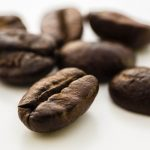 Free stock photo Close-up of coffee beans on white background