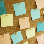 Free stock photo Close-up of multi colored adhesive notes on bulletin board