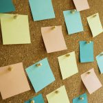 Free stock photo Close-up of multi colored post it notes on bulletin board