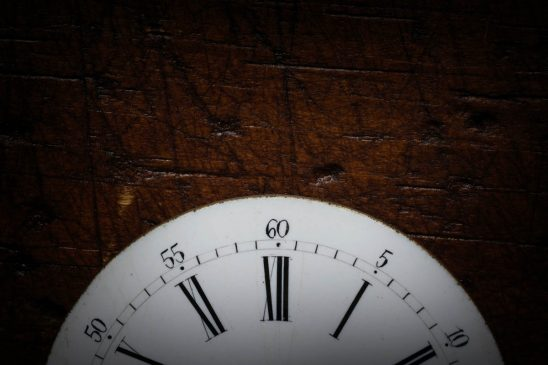 Free stock photo Close-up of antique watch face on wooden table
