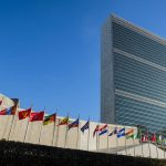 Free stock photo Low angle view of United Nations in New York with national flags