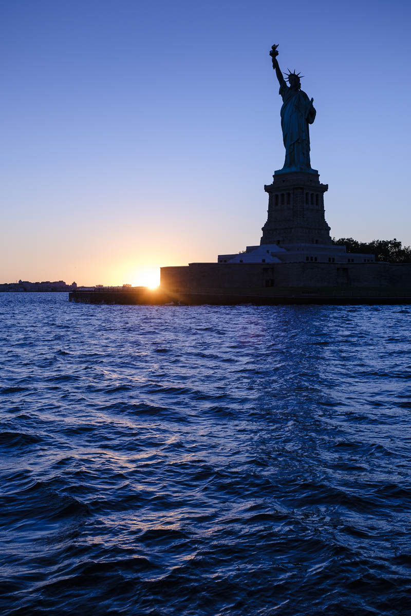 Free stock photo Statue of liberty during sunset
