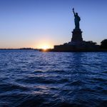 Free stock photo Statue of liberty amidst hudson river during sunset