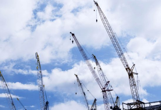 Free stock photo Low angle view of cranes against cloudy sky