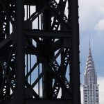 Free stock photo Close-up of industrial crane with Chrysler Building in background